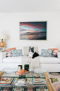 Sunset print above white sofa with a Lulu and Georgia rug in a boho chic living room. Sunset print by Samba to the Sea, The Sunset Shop. paradise found, coastal chic, palm trees, beach chic, coastal California style, costal California design, tropical decor, tropical design, tropical paradise, tropical decorating, tropical decor bohemian, beach shack, surf shack, Costa Rica beach, tropical paradise, tropical oasis, palm trees beach, palm tree beach, paradise found, coastal living, sunset…