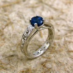 Open cut work completely encircles this beautiful sapphire!