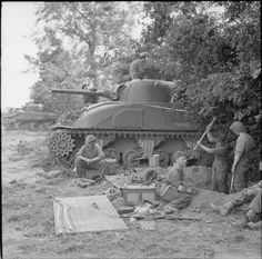 BRITISH ARMY NORMANDY 1944 (B 6225)   Infantry of 49th Division digging in beside Sherman tanks near Rauray, 30 June 1944.
