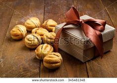 gift in a box of pastries on a wooden background - stock photo