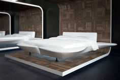 Grandpiano by Flou is a scenographic double bed that resembles a large platform outlined by a comfortable head-board padded with 'Memoform' and by shaped side panels that can also be used as seating or shelving #Beds #Bedroom #Letto #InteriorDesign #HomeDecor #Design #Arredamento #Furnishings #totalwhite