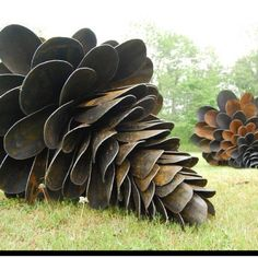 Old shovels made into pine cone sculptures! So clever!