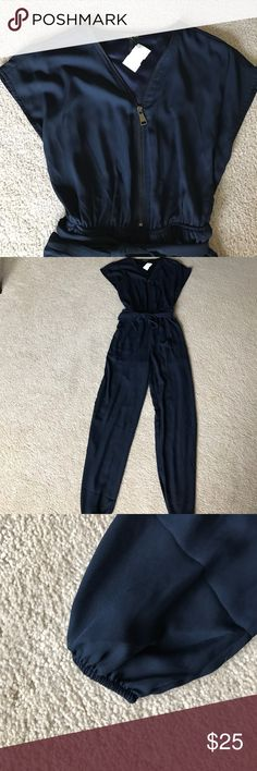 Dottie couture romper large Navy with elastic waist. Working zipper. Runs small. Fits more like medium. Elastic at ankles dottie couture  Pants Jumpsuits & Rompers