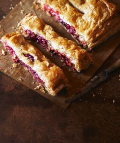 Damson slice: Delicious puff pastry parcels to make a speedy pie. These fruit-filled slices are packed with damsons and marzipan. Best served with lashings of custard.
