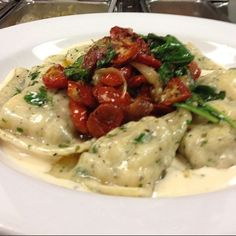 Scallop ravioli w/roasted tomatoes, spinach, and bacon