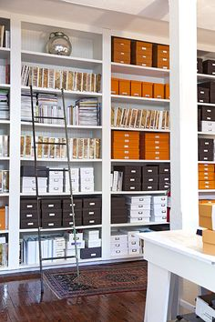 Boxes and binders in a beautifully organized office space -  How To Organize Your Home Office In Style