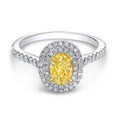 How is this fancy yellow oval diamond engagement ring under five thousand! It's so unique and pretty! I love it!