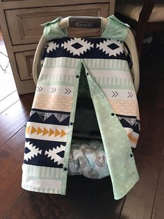 MOD Tribal Aztec Southwest Baby Car Seat Cover - Navy, Light Green, Mint, Coral, Mustard Tribal Print - Gender Neutral Baby Car Seat Cover I LOVE creating new covers for Moms. Its a nice way to keep your newborn baby away from strangers and germs while out and about. This is a super cute and popular modern tribal pattern by designer Art Gallery for the front and mint green with light green diamond print for the back. Trimmed in the same for the straps to keep it from falling off your…