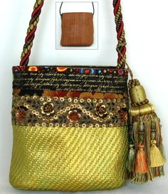 Yes, you can paint that unused summer straw purse. You can also add fabric and trip, replace the strap with home dec cording and add a GIANT tassel. Fun! How to on the  Sassy Feet DIY Handbags page