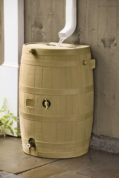 Rain barrel for collecting rain water and using it for watering plants