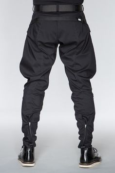 ACRONYM GmbH — P13-CH: A sculpted, three dimensionally patterned pant derived from traditional military and riding jodhpurs. Cut with the Acronym® DFMA high reach gusset and articulated knees, P13 offers no resistance to moves in virtually any direction. The separating 5mm reverse coil zip cuffs can be worn open, or zipped shut to various heights for variable shaping of the lower leg //
