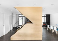 Maple and steel staircase added to a 1960s house.