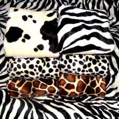 Beautifully soft and vibrant baby blankets in funky faux fur animal prints. Great for tummy time and under treasure baskets.