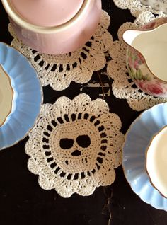 Ivory skull crocheted coasters. Check out Vint-Ange on Facebook.