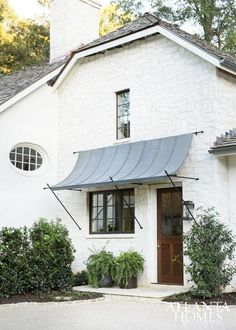 Blue roof, copper awning, black windows