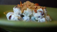 Best Grape Salad with cream cheese, green and purple grapes, pecans and brown sugar.... so good!  Great for potlucks.