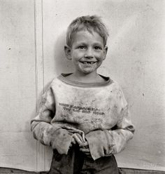 "November 1938. ""Migrant cotton picker's child who lives in a tent in the government camp instead of along the highway or in a ditch bank. Shafter Camp, California.""by Dorothea Lange. - my grandfather was an Okie migrant worker as well."