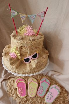 "Sandcastle cake - I like the mini pennant garland.  Too cute! That's an easy way to ""write"" on a cake with an odd shape..... This would be cook with cheese cake inside and gram cracker on the ouside."