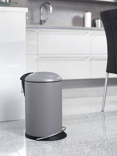 The special designer pedal waste bin with foot rail, coloured in matt grey.