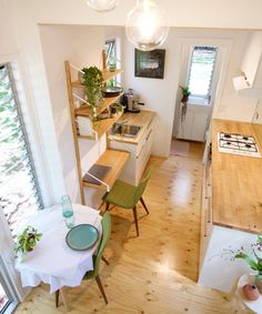 The galley kitchen is outfitted with a gas cooktop, oven, and under counter refrigerator.