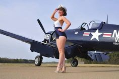 1940's Style Navy Pin-Up Girl Posing with a Vintage Corsair Aircraft Photographic Print