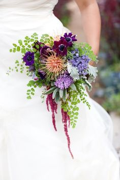 What a beautiful bouquet... sweet, drapey...it is woodland meets tropical with the ferns, anemone and pin cushion protea.