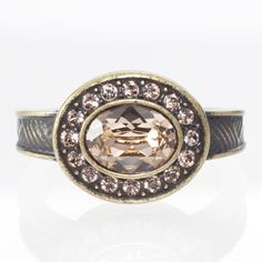 Sonoma Ring $39 Light Peach crystal; antique bronze plating. www.touchstonecrystal.com/carole