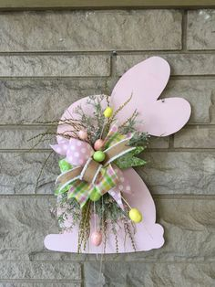 This easter door hanger is made of wood. Bunny measures 22 inches Has a mix of ribbon,greenery and Easter eggs. ** ribbon and greenery may vary depending on stock, but will still be super cute! This new design will have your door the envy of the neighborhood! We are proud to say ""
