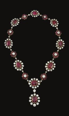 PROPERTY OF AN ITALIAN NOBLE FAMILY: Ruby and diamond necklace. The necklace set with circular-cut, cushion-shaped and oval rubies, highlighted with circular-cut diamonds.