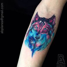 Galaxy style wolf on the forearm. Tattoo artist: Adrian Bascur