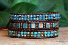 NEW IN THE SHOP! This beaded leather triple wrap bracelet features a gorgeous assortment of top quality Czech Crystal and Glass Beads, highlighted by lovely Miyuki Seed Beads. At its centre are Turquoise Bronze Czech Glass Tile Beads with a lovely picasso finish, interspersed with Miyuki Matte Metallic Bronze Seed Beads. These are surrounded by beautiful, sparkly, lead-free Turquoise Two-Tone Crystal Rondelle Beads on one side, and a combination of sparkly Blue Crystal and Miyuki Seed Beads…