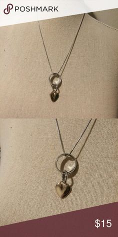 Silver necklace with heart & ring This is a 2 in 1 necklace. The ring can be worn alone on the finger (size 7). It has a gold color heart. Brand new never worn. Jewelry Necklaces