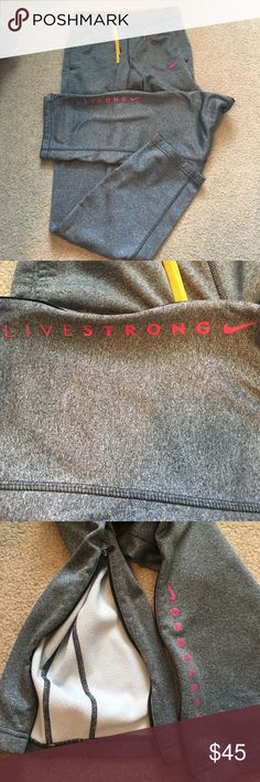 Nike LIVESTRONG Sweatpants Super cute comfy Nike Therma - Fit LiveStrong gray sweats with pink wording. Selling from a pet and smoke free home! Still in good condition. Nike Pants Track Pants & Joggers