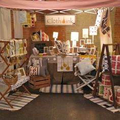 Cloth & Ink booth display - Love the drying rack turned shelves
