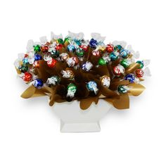 Lindt Sensation Large  Lindt Sensation Large is one of our biggest arrangements. It consists of  60 assorted mixed Lindt Lindor Balls.   Dressed to impress, this stunning arrangement is well suited for any occasion and is arranged in a beautiful ceramic vase.   Lindt Sensation Large comes with a COMPLIMENTARY gift message card.   Next day delivery available to most Sydney Metro and Central Coast areas.   Overnight delivery available to most Blue Mountains, Newcastle and Wollongong Area