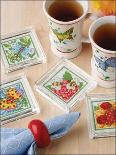 Gentle garden creatures alight inside these acrylic coasters-they're a year-round reminder of a beautiful summer. Coaster Stitch Count: 34 wide x 34 high. Cross Stitching, Cross Stitch Embroidery, Cross Stitch Patterns, Butterfly Cross Stitch, Cross Stitch Flowers, Cross Stitch Kitchen, Cross Stitch Needles, Crochet Cross, Labor