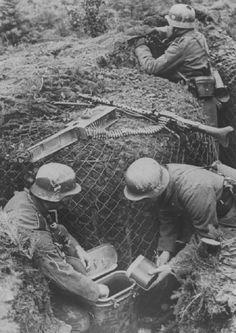 German machine gun team taking a break for lunch