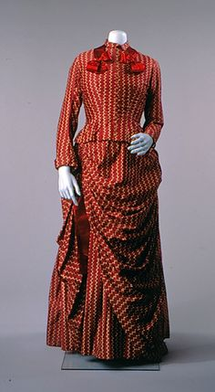 Dress: 1886, sateen/glazed cotton with dots and lines print, silk ribbon, buttons, bodice lined in cotton, skirt lined with polished cotton.
