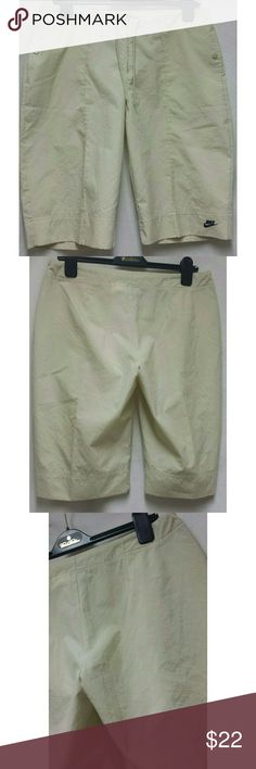 NIKE board shorts As shown,  mint condition, ecru, drawstring, zip, flat front, knee length shorts. Size marked 8-10 Nike Shorts Bermudas