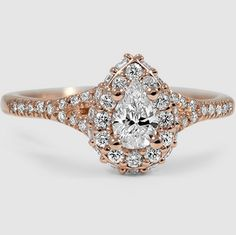 A rose gold halo setting is made even more glamorous by an additional row of pavé set diamonds.