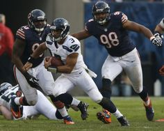 Seahawks quarterback Russell Wilson (3) runs for an 8-yard gain in the fourth quarter past Bears defensive end Corey Wootton (98) and defensive tackle Nate Collins (93). (José M. Osorio, Chicago Tribune / December 2, 2012)