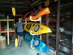 We recently bought a couple of kayaks, so I had to come up with a way to store them. After doing a little research, I determined that storing them on their side, without any hard pressure points, w...