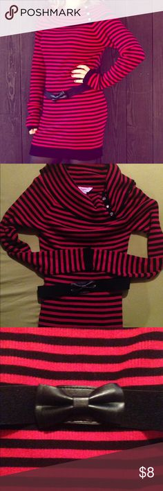 Long Sleeve Sweater Dress Sized XL in Juniors. Brand is Candies. Sweater dress is long sleeve and comes a bit above the knee (dependent on height of course). Color is black and red striped. Around neckline has one of those sweater necks that falls to look kind of like a scarf (pictured, has jewels on the side of it). Comes with a cute elastic type belt embellished with a bow on the front (also pictured). Only worn once! Candie's Dresses Long Sleeve