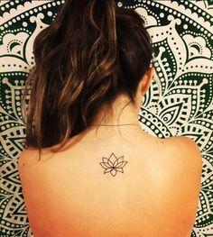 Simple Small Lotus Flower tattoo Idea on Back