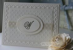 white on white handmade wedding card ... lots of texture and several layers ... like the initial on a die cut oval on diminsionals over the embossed frame ... Stampin' Up!
