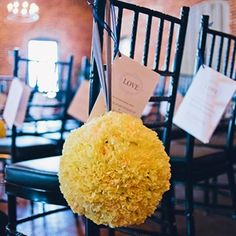 Ceremony programs were tied to each chair with ribbon, and pomanders decked the chairs along the aisle.