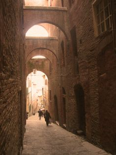 Siena Alley: As I walked down Via della Sapienza the facades of ancient houses closed in on me from all sides, and I was soon trapped in a labyrinth of centuries past, following the logic of an earlier way of life.