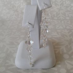 Sparkly drop earrings with round Swarovski crystals in graduated sizes to form a delicate crystal icicle, perfect for Christmas parties!  The
