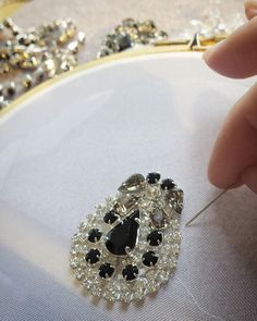 Working on a custom piece. #embroidery #handembroidery #luneville #broderie #weddinghairpiece #blackcrystal #clearcrystal #handmade #glimpsecreations