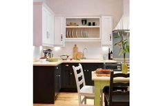 Dark units at base level, white or light coloured units at eye level. The trick? Makes the kitchen look less narrow and much wider.